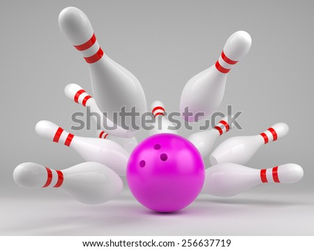 Pink bowling ball and scattered skittles - stock photo