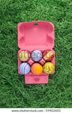 Pink box of rough stroked easter eggs. Put your text in cap. - stock photo