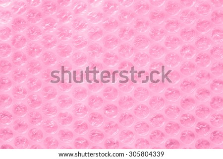 pink bubble wrap or packing material as abstract background - stock photo