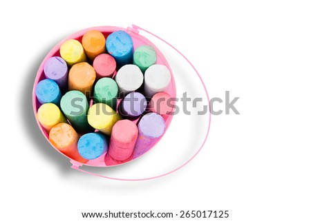 Pink bucket of colorful chalk crayons viewed from above isolated on white for young kids entertainment, creativity and education - let us draw with chalks - with copyspace - stock photo