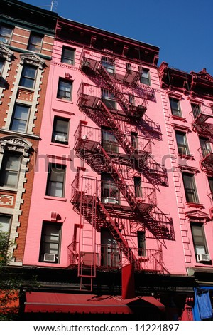 Pink building with metallic stairs in SoHo - New York City, USA - stock photo