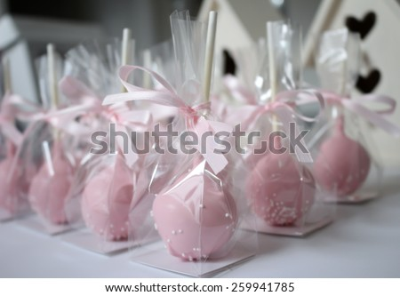 Pink cake pops wrapped - stock photo
