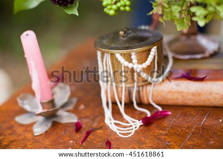pink candle and copper box with beads - stock photo