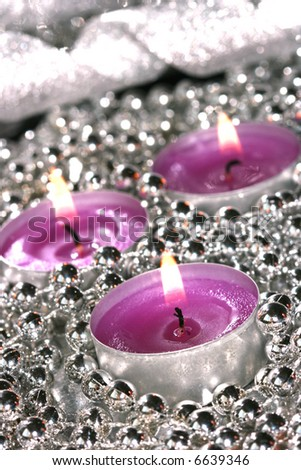 pink candles with silver decoration balls - stock photo