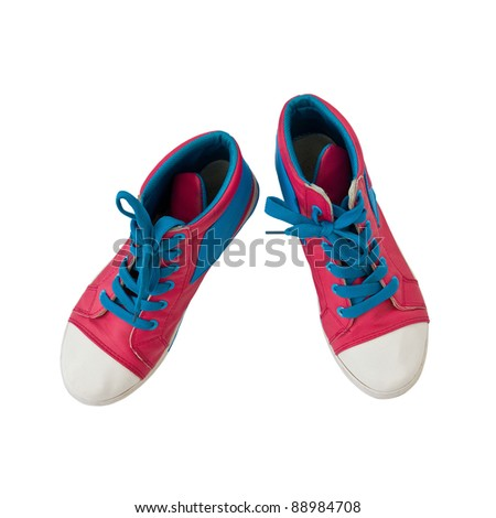 Pink canvas shoes on white background