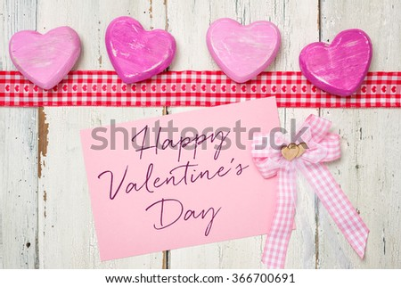 Pink card with the inscription Happy Valentines Day - stock photo