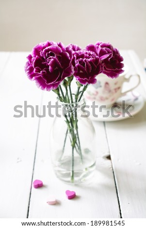 Pink carnations flower bouquet in a  vase - stock photo