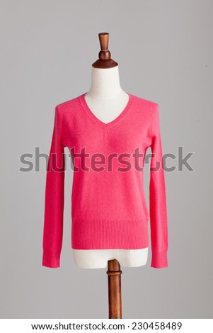 pink cashmere sweater with wood model on grey isolated - stock photo