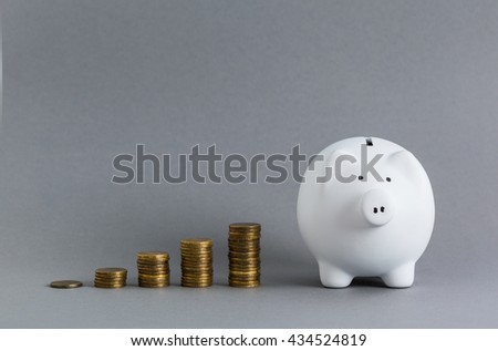 pink ceramic piggy bank over a grey background  - stock photo