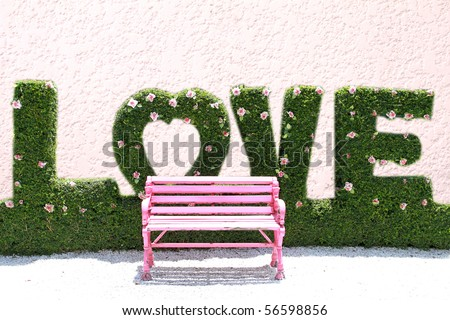 pink chair in love garden - stock photo