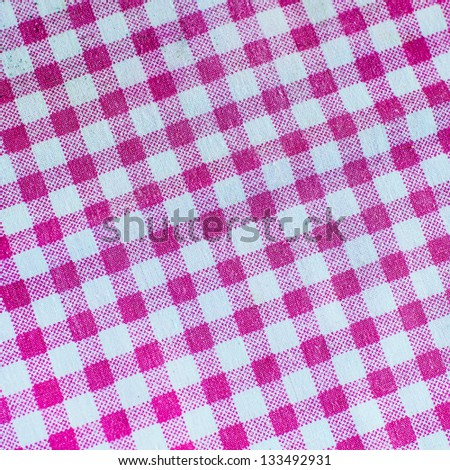 Pink checked fabric tablecloth - stock photo