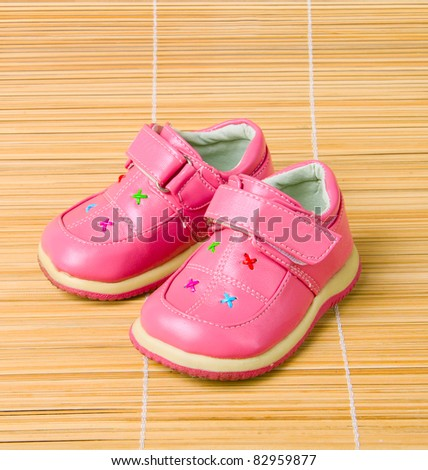 Pink children's shoes #3 on bamboo
