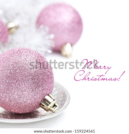 pink Christmas ball and tinsel close-up, isolated on white