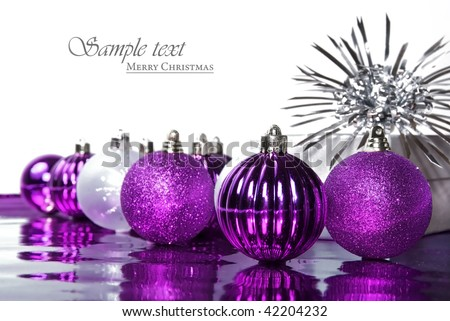 Pink christmas baubles against a white background with space for text - stock photo