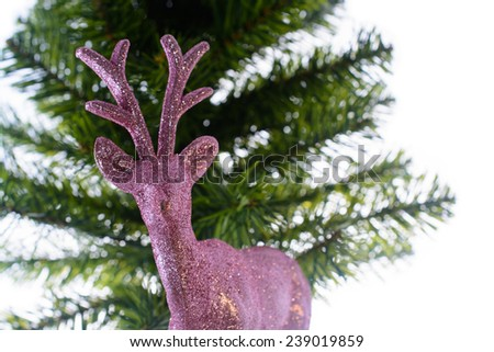 pink Christmas deer and Christmas tree Isolated On White background - stock photo