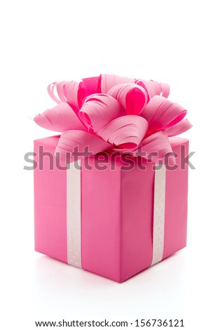 Pink Christmas gift with ribbon and bow isolated on white background