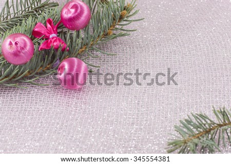 Pink Christmas ornaments and fir tree on sparkling background. Celebrating Christmas - stock photo