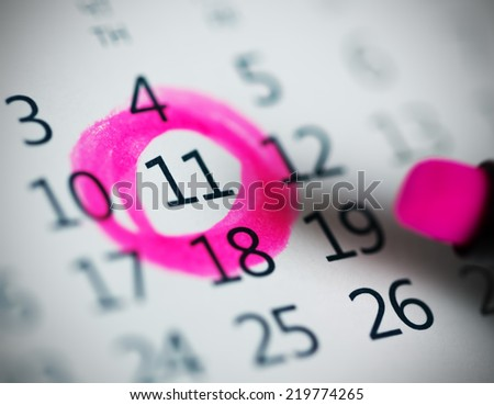 Pink circle. Mark on the calendar at 11. - stock photo