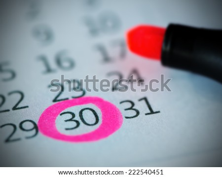 Pink circle. Mark on the calendar at 30. - stock photo