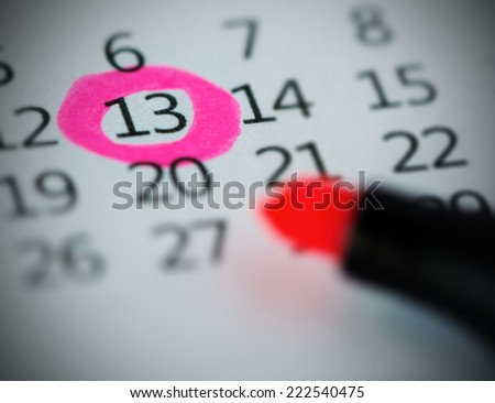Pink circle. Mark on the calendar at 13. - stock photo