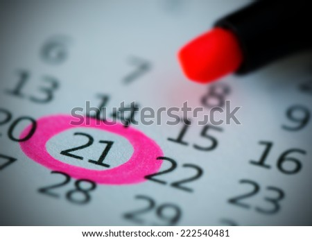 Pink circle. Mark on the calendar at 21. - stock photo