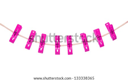pink clothespin hang on rope (clothesline) isolated on white background - stock photo
