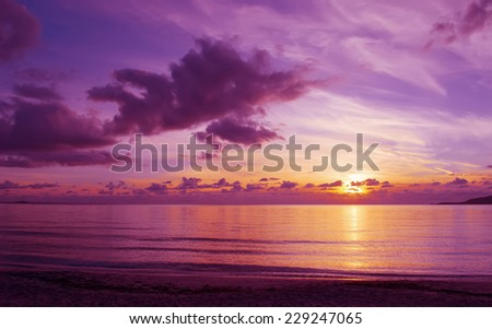 pink cloudy sunset in Alghero, Italy. - stock photo