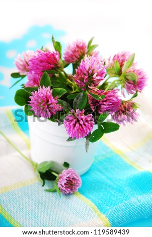 pink clover flowers bouquet on the table - stock photo