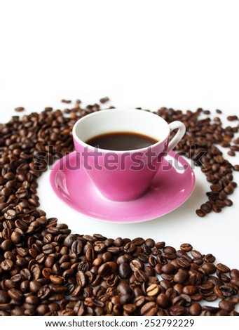 Pink coffee cup in a circle of coffee beans in perspective 2 - stock photo