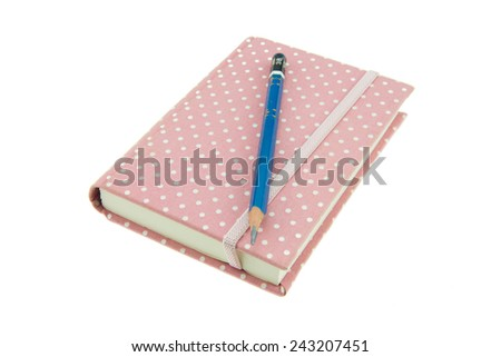 Pink color cover fabric note book and pencil isolated on white background - stock photo
