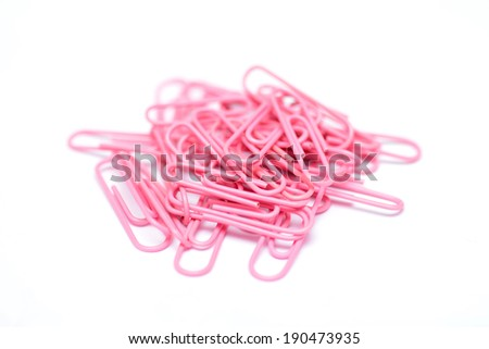 pink color paper clips arranged on isolated white background. - stock photo