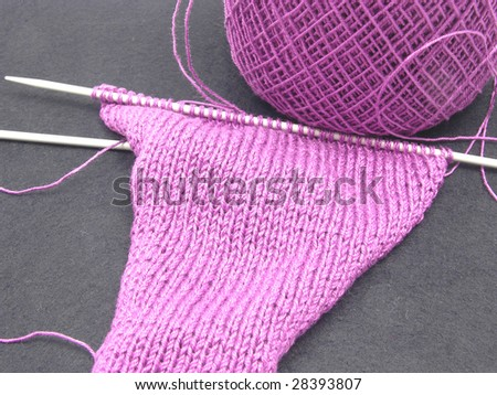 Pink colored knitting on a  black background