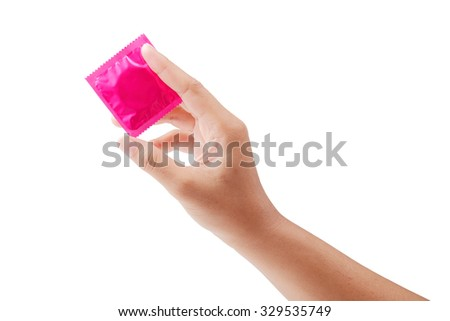 Pink condom in female hand isolated on a white background, clipping path. - stock photo