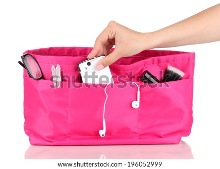 Pink cosmetic bag and female hand isolated on white - stock photo