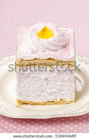 Pink cream cake on pink background - stock photo