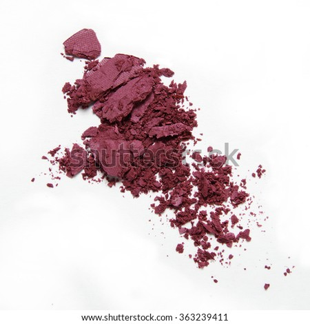 pink crumbled blush and eyeshadow on white background