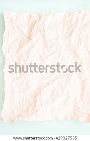 Pink crumpled paper and blue  paper texture background.