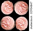 Pink cup cakes on a black background - stock photo