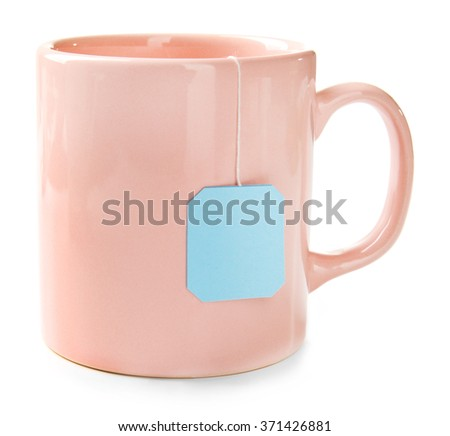 Pink cup of tea isolated on white background. Teabag with blue label - stock photo