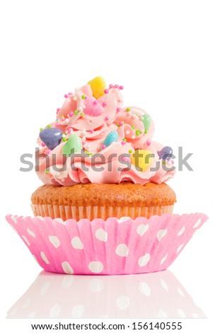 Pink cupcake isolated on white background - stock photo