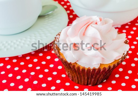 Pink cupcake on the table