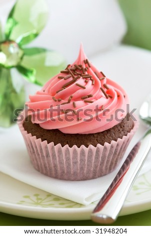 Pink cupcake, ready to eat - stock photo