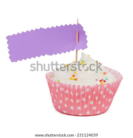 Pink cupcake with sprinkles with copy space to side isolated on a white background - stock photo