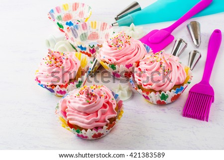 Pink cupcakes  and kitchen utensils. Birthday cupcakes. Sweet dessert pastry.  Homemade gourmet cupcakes.