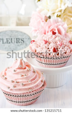 Pink cupcakes and roses for party. - stock photo