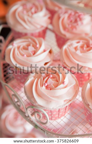 Pink cupcakes on shelf for wedding or valentine close up - stock photo