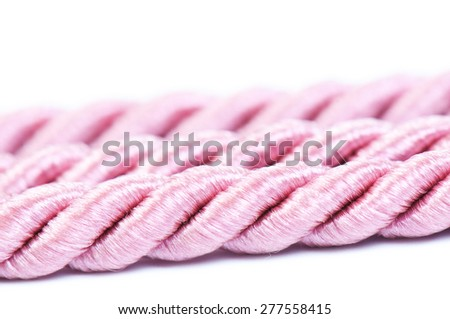 pink decorative rope for use in a decor - stock photo