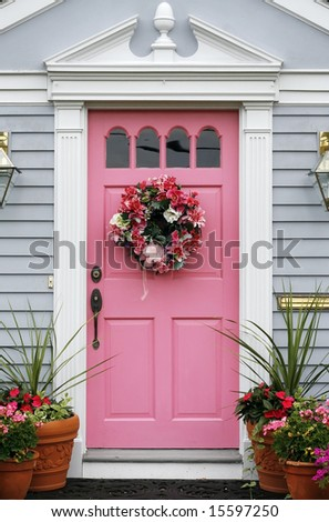 pink door with wreath - stock photo