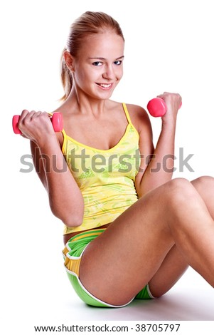 pink dumbbells in the hands of women on a white background
