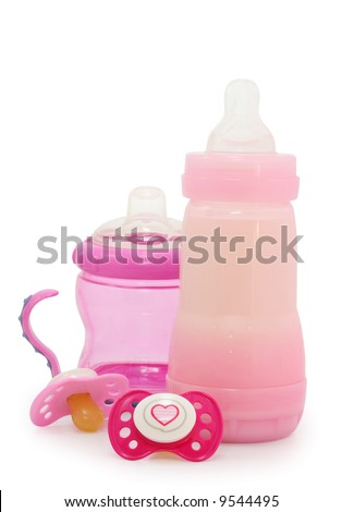 pink dummies and bottles on white - stock photo